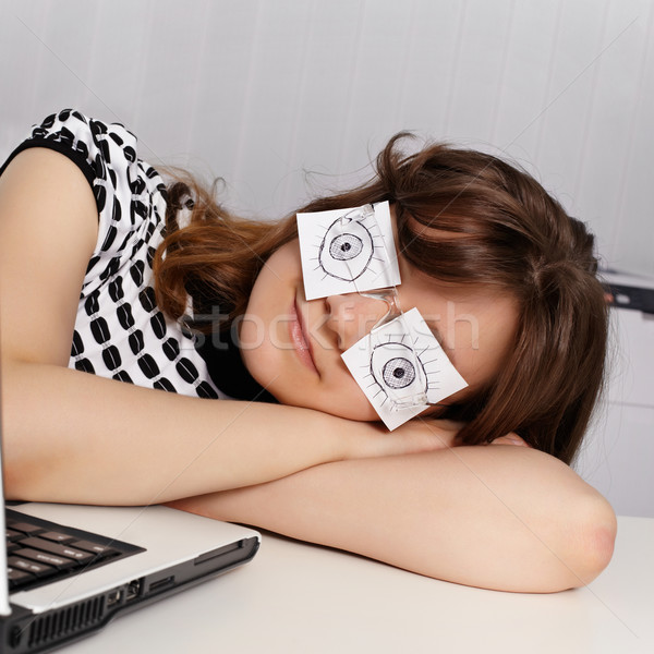 Woman sleeps in the office during working hours Stock photo © pzaxe