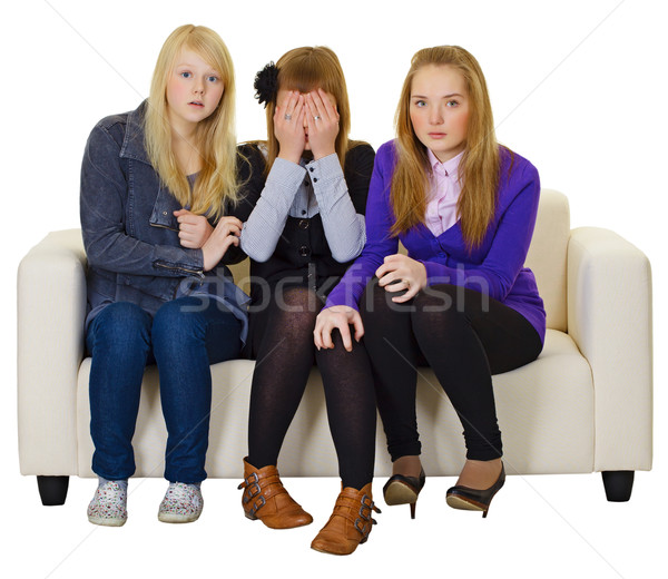 Três meninas veja horror filme sofá Foto stock © pzaxe
