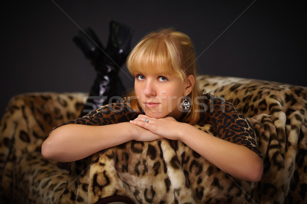 Young beautiful girl lying on sofa Stock photo © pzaxe