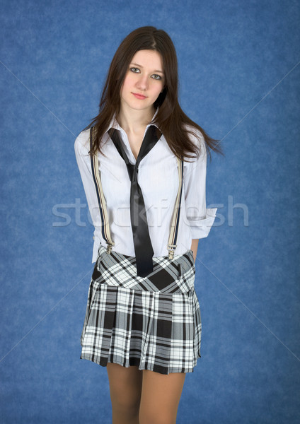 Girl in a skirt on a blue background Stock photo © pzaxe