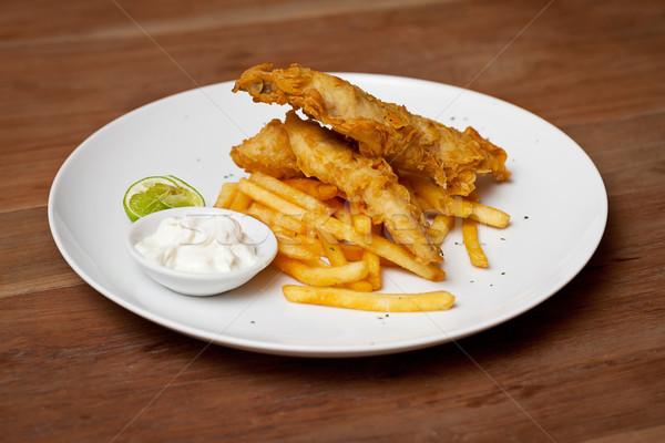 Shrimp tempura dish with white sauce and fried potatoes Stock photo © pzaxe