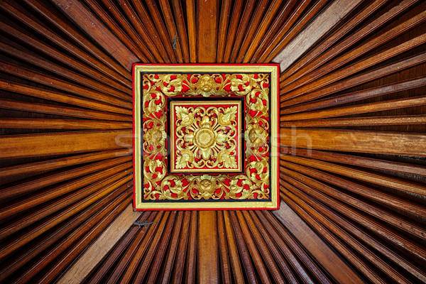 Beautiful, Symetrical, Hand Carved Wooden Ceiling Tile with Live Stock photo © pzaxe