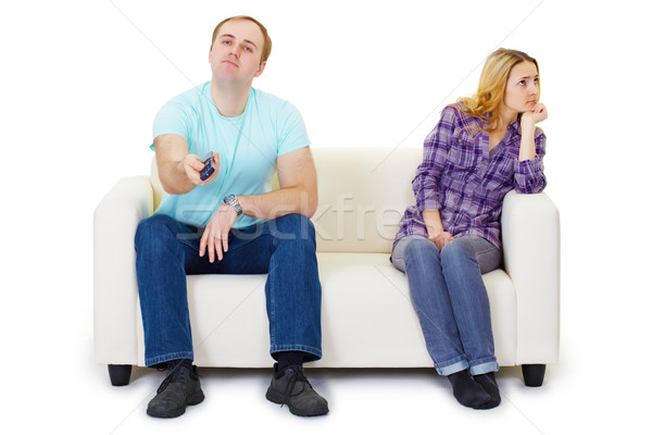 Husband and wife in a quarrel sit on couch watching TV Stock photo © pzaxe