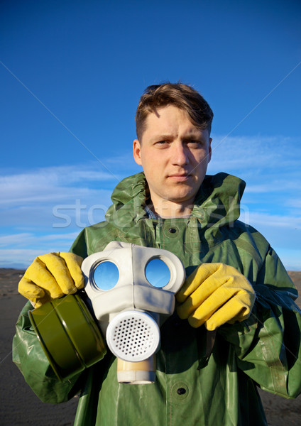 Man in a overalls with a gas mask Stock photo © pzaxe