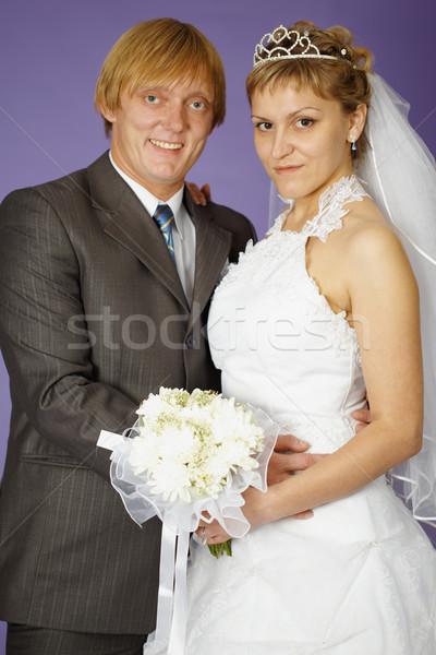 Düğün portre yeni evliler mor çiçekler yüz Stok fotoğraf © pzaxe