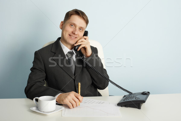 Smiling businessman in talks on phone Stock photo © pzaxe
