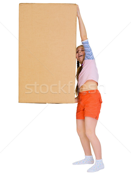 Stock photo: Small cheerful girl drags big cardboard box isolated on white