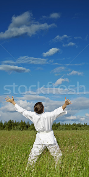 Person has lifted hands to blue sky - happiness Stock photo © pzaxe
