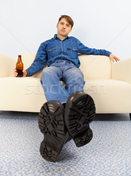 Drunk dude sprawled on couch Stock photo © pzaxe