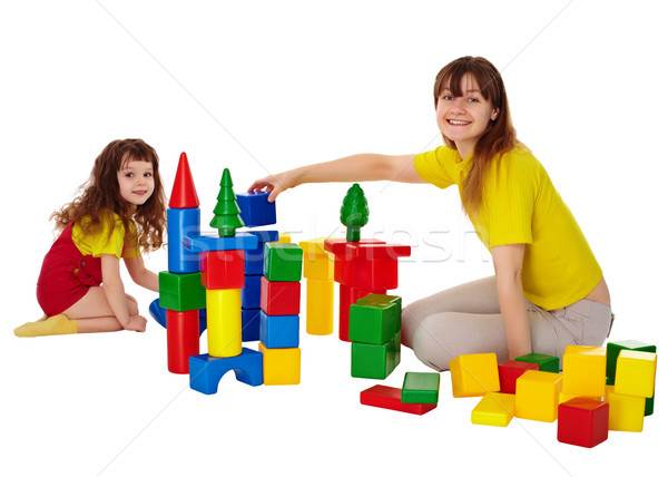 Happy mother and daughter playing with blocks Stock photo © pzaxe