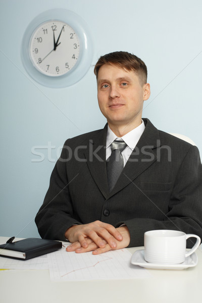 Young chief sitting on workplace Stock photo © pzaxe