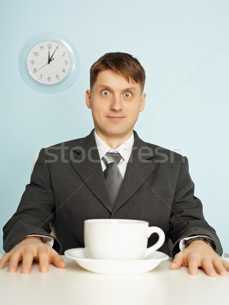Businessman has drunk coffee and stare wide-eyes Stock photo © pzaxe