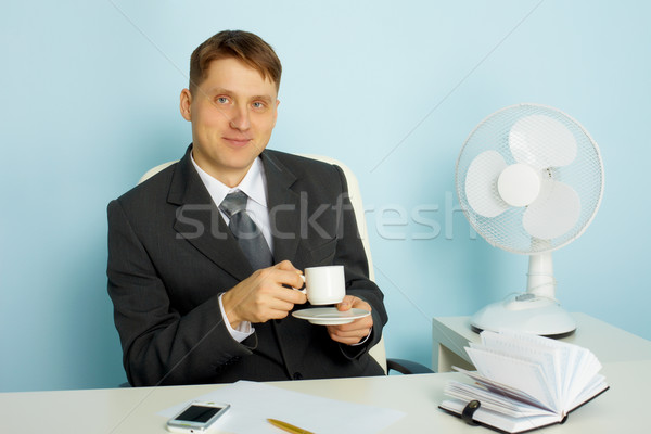 Attractive young man with a cup of coffee Stock photo © pzaxe