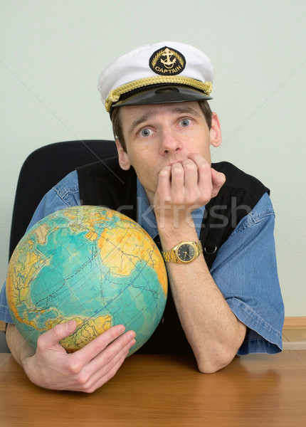 Seaman misses on distant travel sitting at table with globe Stock photo © pzaxe