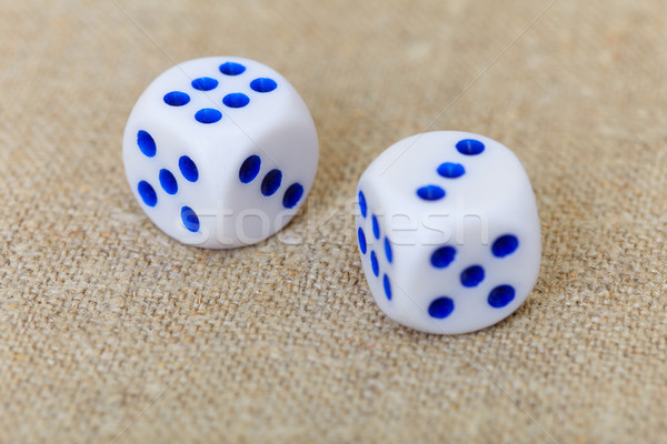 Two dice on coarse linen Stock photo © pzaxe