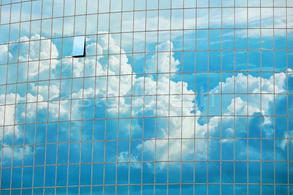 Sky reflected in the skyscraper windows background Stock photo © pzaxe