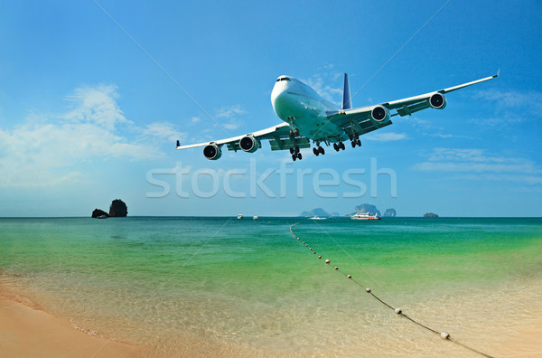 Traveling to tropical countries by airplane Stock photo © pzaxe
