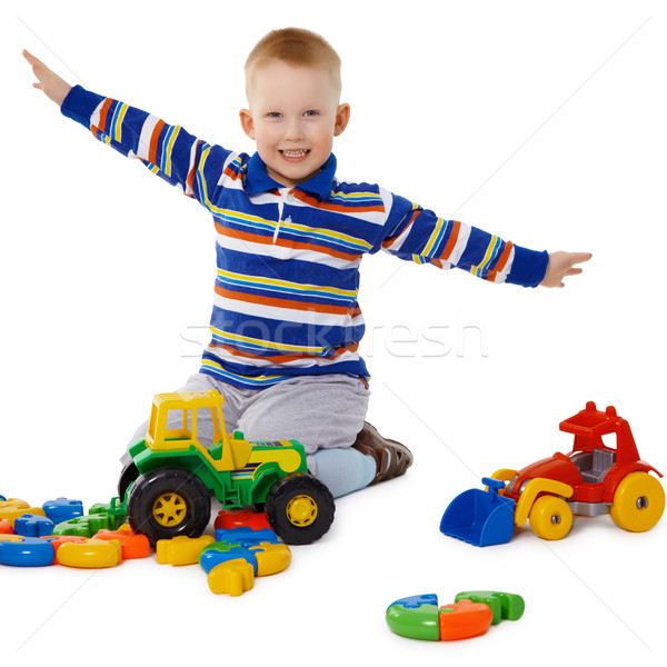 Little boy playing with color toys on floor Stock photo © pzaxe
