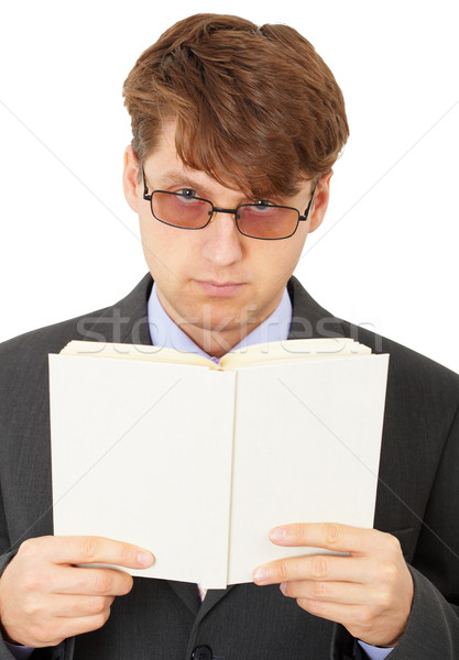 Serious man gets acquainted with contents of book Stock photo © pzaxe