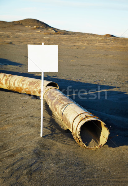 Sign near old rotting pipe - ecological disaster Stock photo © pzaxe