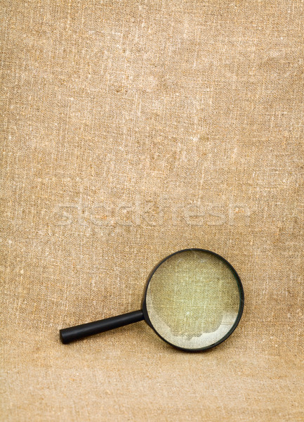 Magnifying glass on the sacking Stock photo © pzaxe