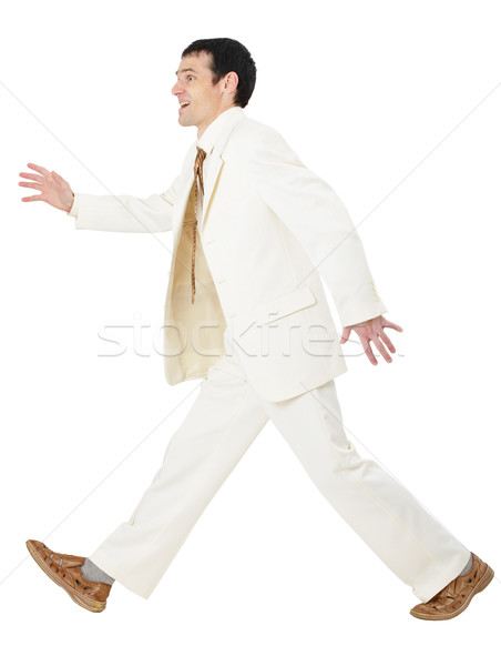 Happy businessman somewhere in a hurry Stock photo © pzaxe