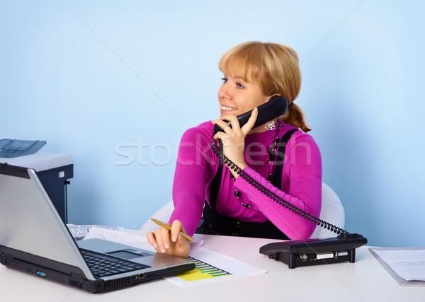 Attractive girl secretary talking on phone Stock photo © pzaxe