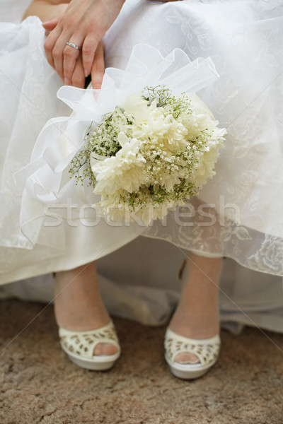 Bouquet of bride against dress and shoes Stock photo © pzaxe