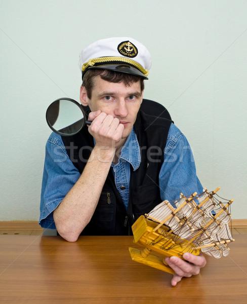 Man in uniform cap with sailer Stock photo © pzaxe