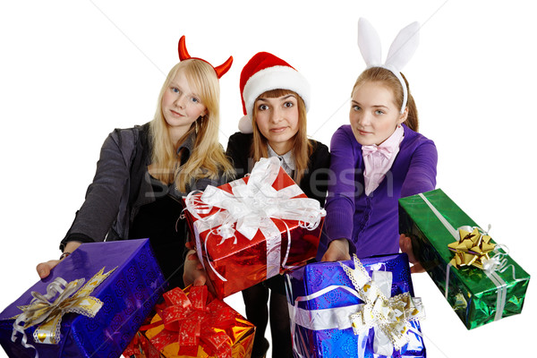 Three girls hand over New Year's gifts Stock photo © pzaxe