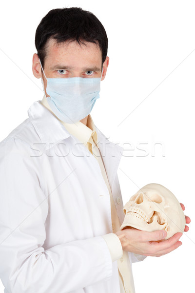 Young doctor in medical mask with a skull Stock photo © pzaxe