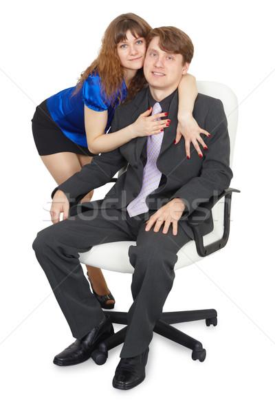 Femme jeune homme chaise de bureau séance affaires homme Photo stock © pzaxe