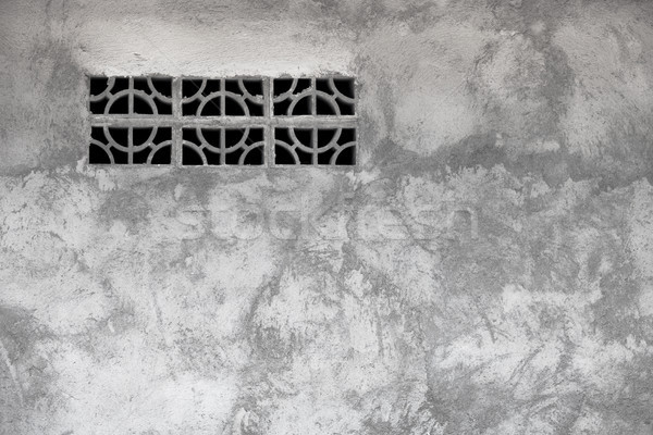 Gray rough concrete wall with ventilation window Stock photo © pzaxe
