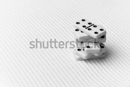 Two dice on yellow sand Stock photo © pzaxe