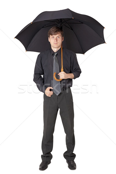 Stock photo: Serious man in black clothes with an umbrella