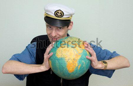 Girl in sea uniform and globe Stock photo © pzaxe