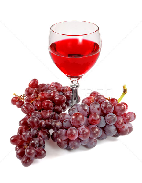 Glass of red wine and grapes clusters Stock photo © pzaxe
