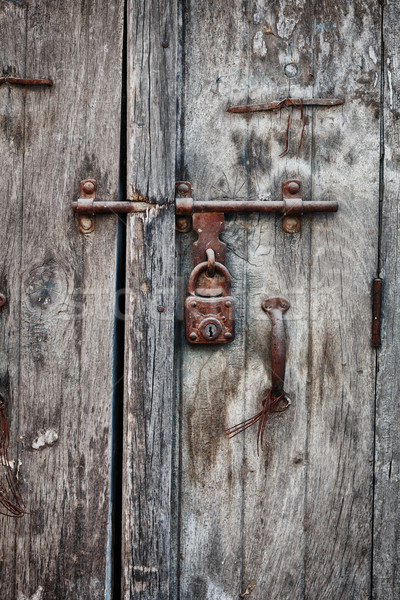 Rusty padlock on an old wooden door of the house Stock photo © pzaxe