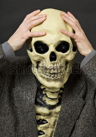Skeleton has clasped hands a skull Stock photo © pzaxe
