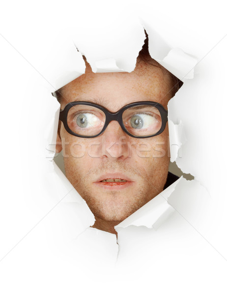 Funny man in an old-fashioned glasses looking out of hole Stock photo © pzaxe