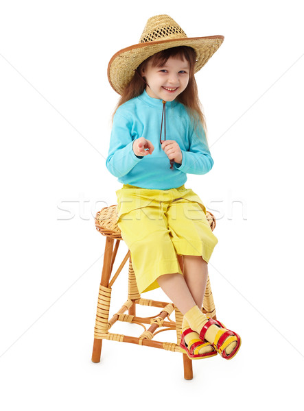 Little girl in straw hat sitting on wooden chair Stock photo © pzaxe