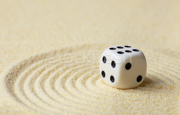 Dice with against yellow sand Stock photo © pzaxe