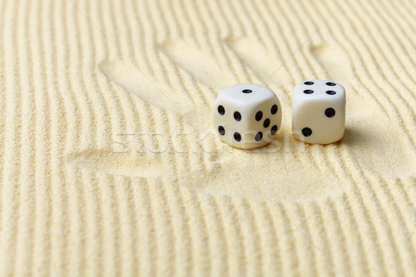 Dices on sand surface and palm print - art composition Stock photo © pzaxe