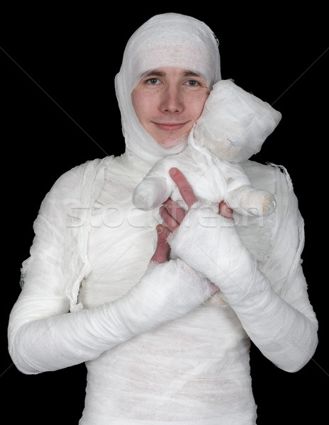 Sentimental man in bandage with mummy bear Stock photo © pzaxe