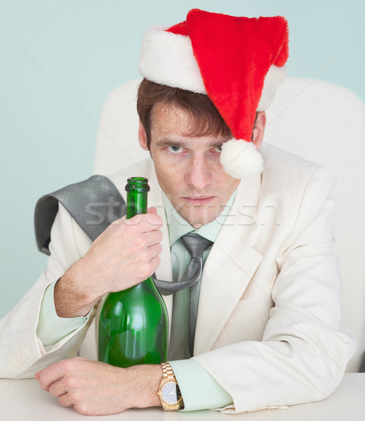 Drunk and tired guy in white jacket with bottle celebrates Chris Stock photo © pzaxe