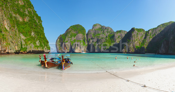 Tropical beach with boats and rocks. Thailand, Phi Phi Stock photo © pzaxe