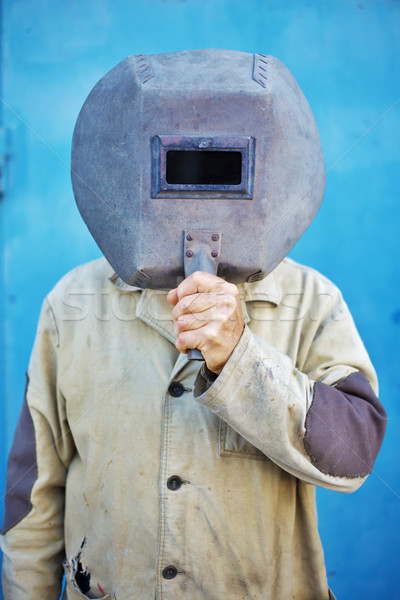 Builder - welder with old welding mask Stock photo © pzaxe
