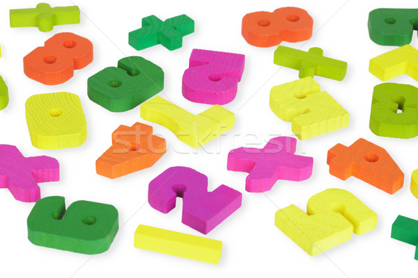 Multi-colored wooden toy figures on white Stock photo © pzaxe