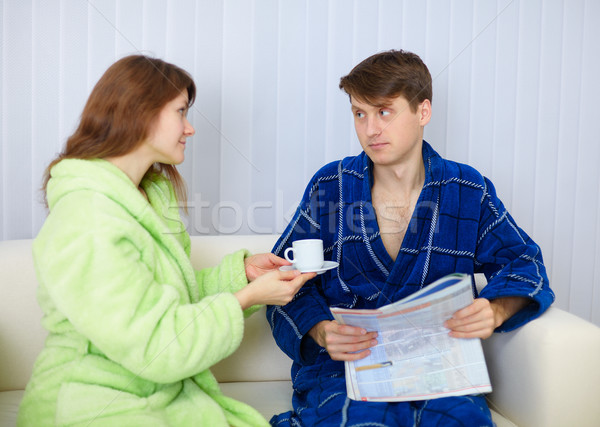 Young couple in dressing gowns sitting on couch Stock photo © pzaxe
