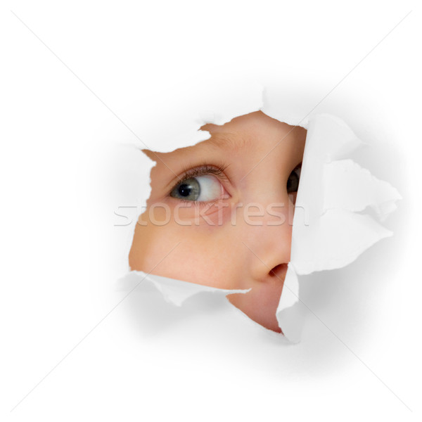 Childish eye looking from hole in paper Stock photo © pzaxe